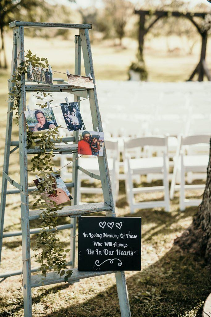 ladder with memorial photos at farm wedding