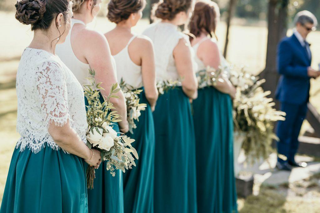 bridesmaids stand during wedding ceremony