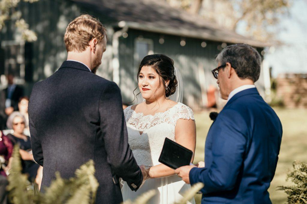 bride and groom at farm wedding ceremony
