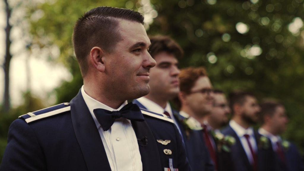 groom and groomsmen wait for bride