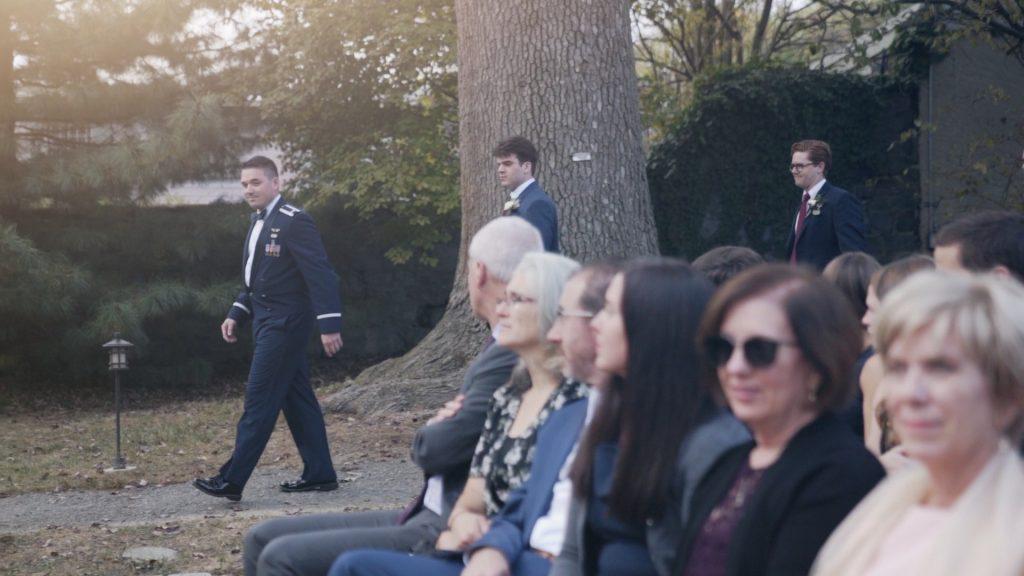 groom walk down aisle at wedding