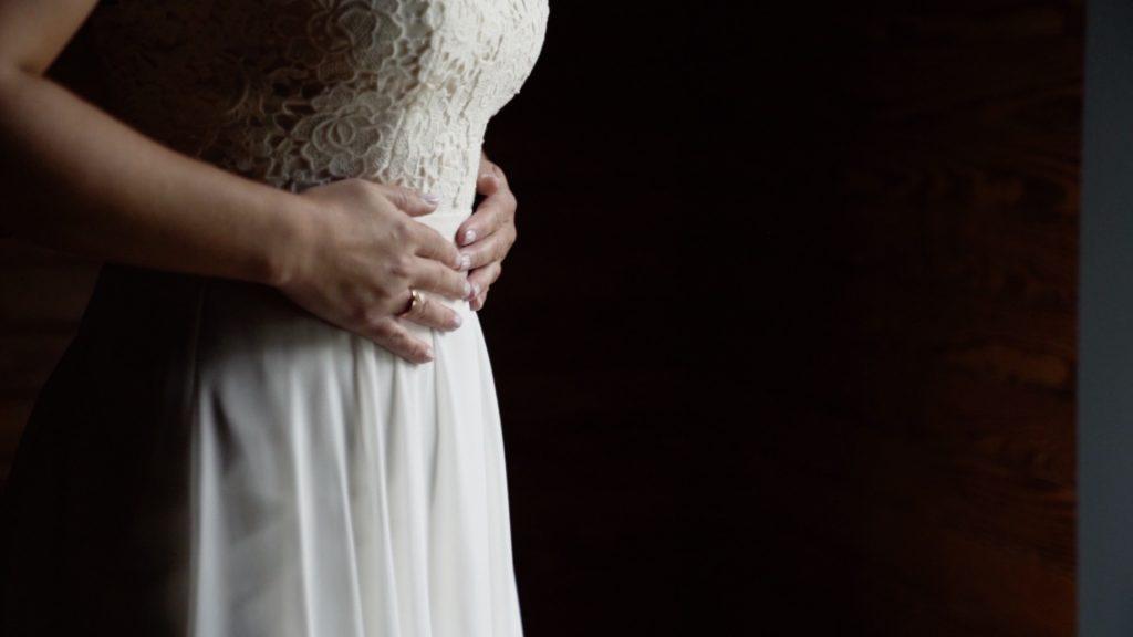 bide wearing wedding dress and band