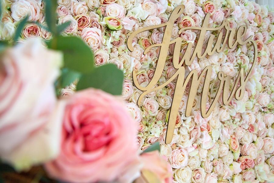 floral wall with future mrs sign