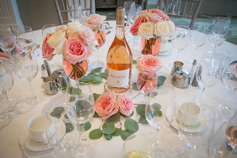 pink floral table top with wine