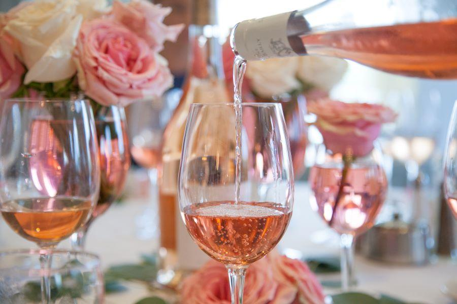 wine poured in glasses at bridal shower