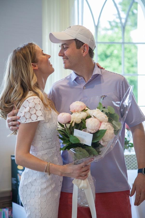 couple embrace with flowers at bridal shower