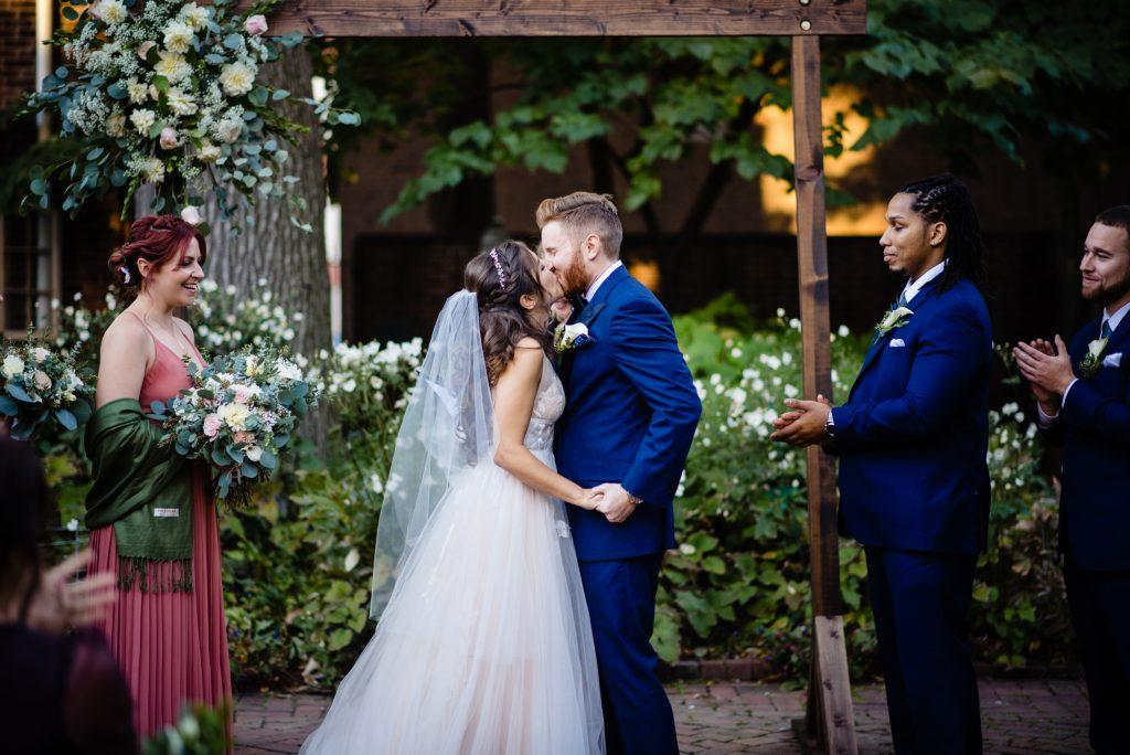 bride and groom kiss at wedding, nicole cordisco photography