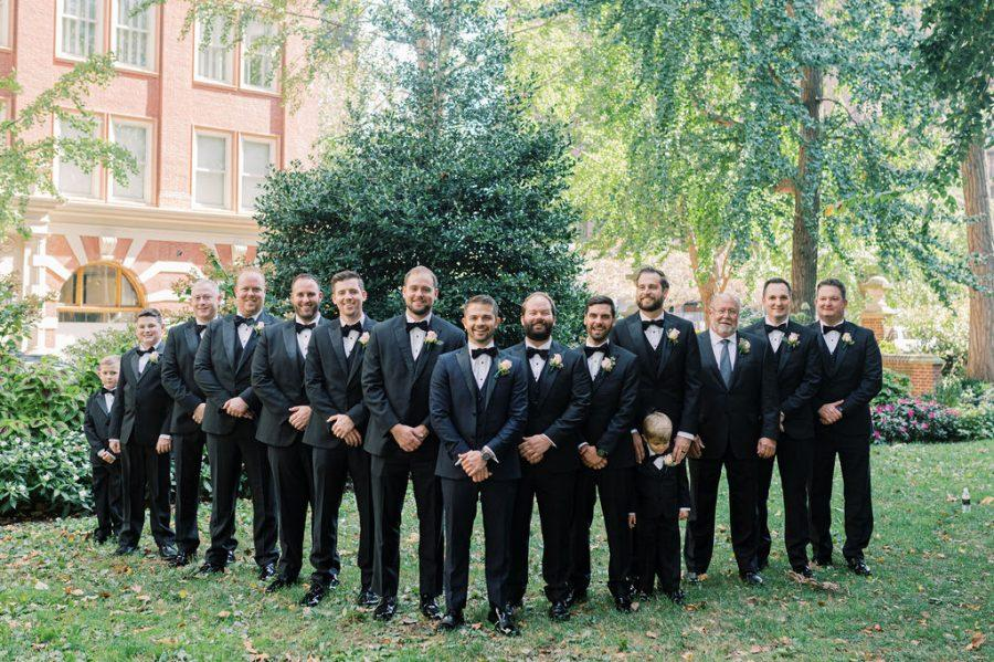 groom and groomsmen pose outside