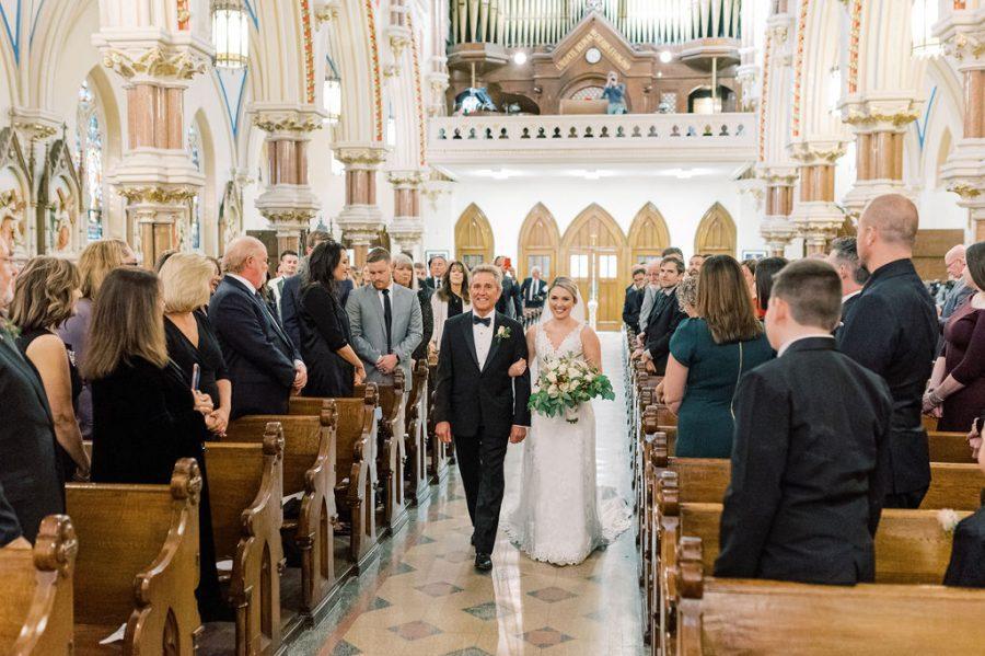 bride walks down aisle with dad