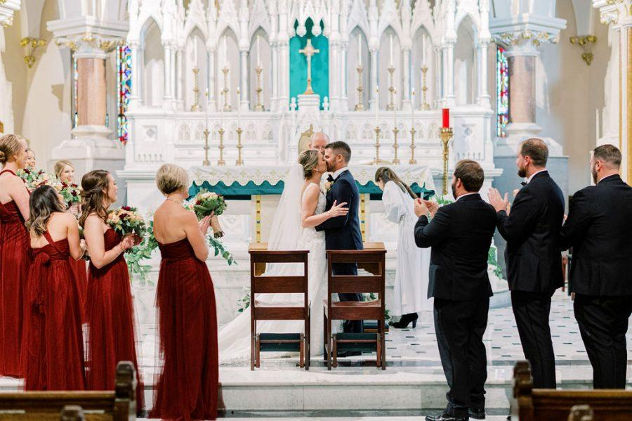 bride and groom's first kiss at church wedding