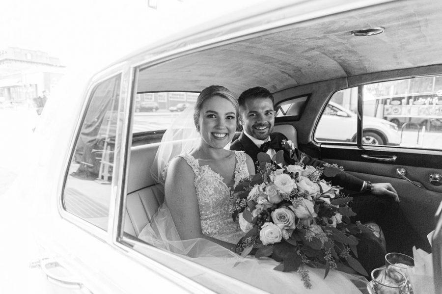 bride and groom in white rolls royce