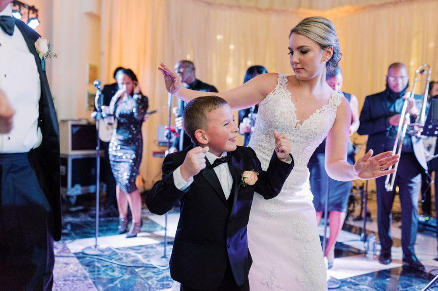bride dancing with little boy at weddingreception