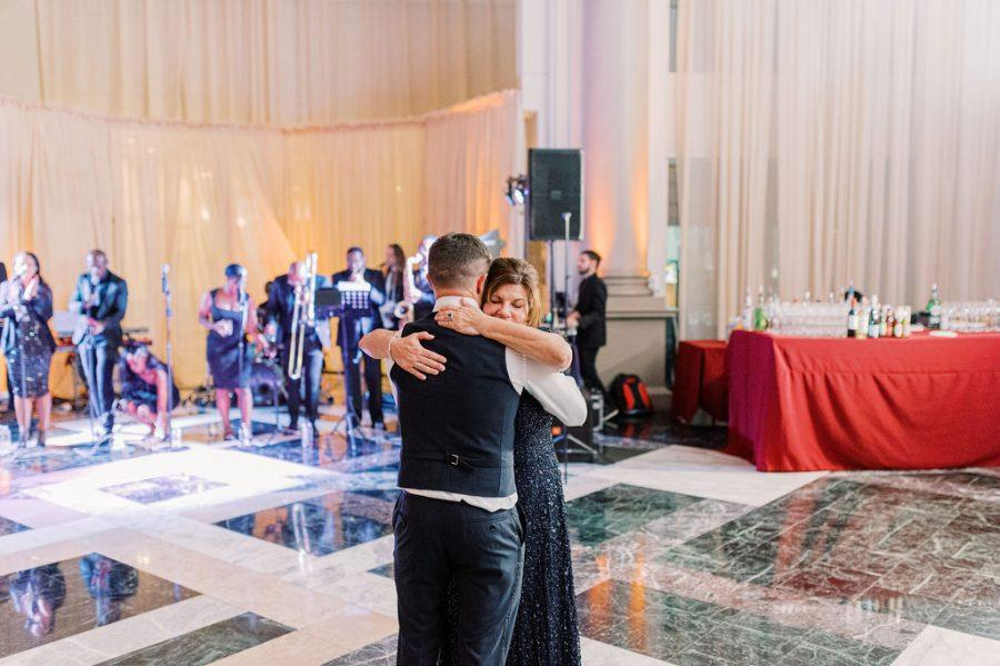 groom dancing with mom at wedding reception