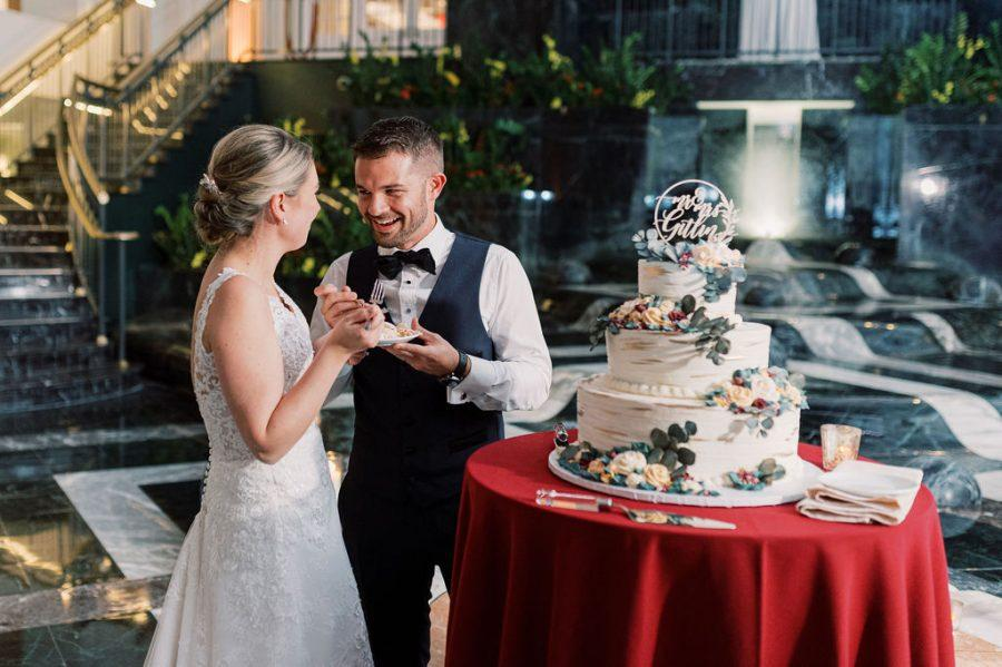 couple eating their wedding cake
