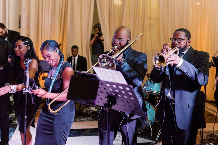 band with singers and horns play at wedding