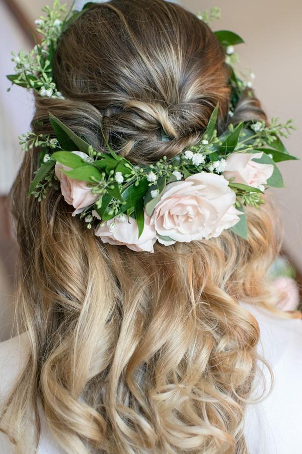 bride wearing roses in hair