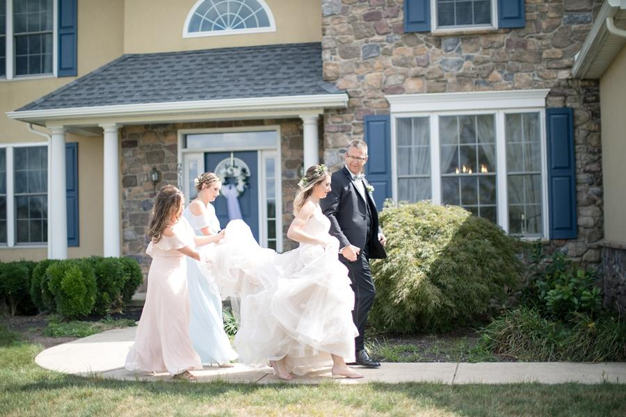 bride and family outside house