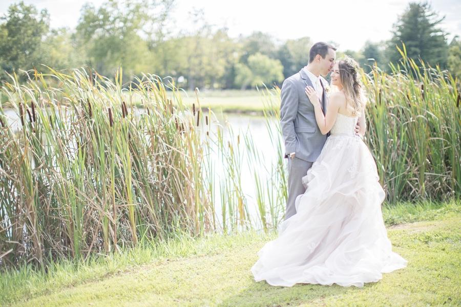bride and groom outside in grass
