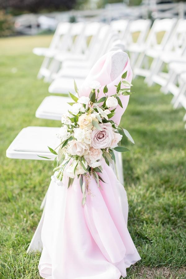 pink roses on wedding chairs