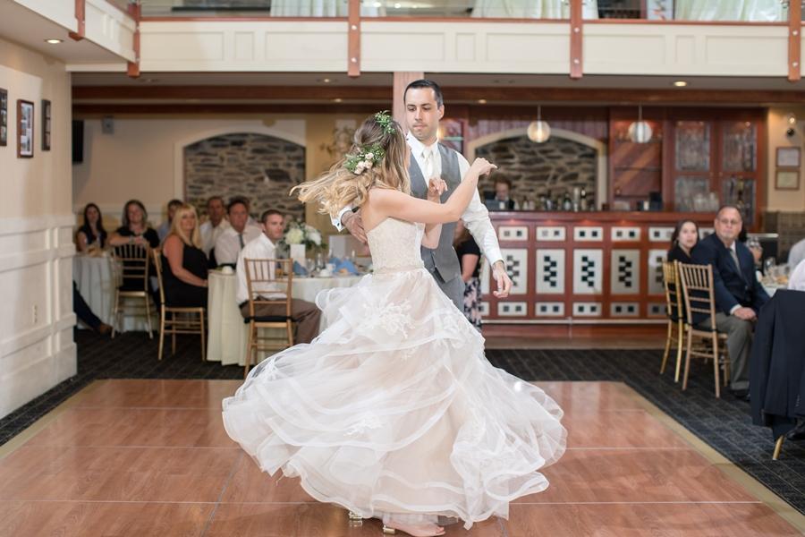 groom spins bride on dance floor