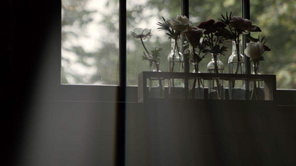cut flowers on window ledge