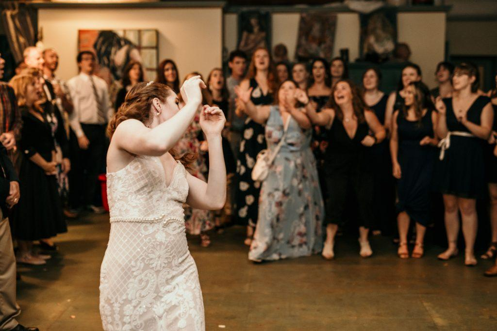 bride throws flower crown