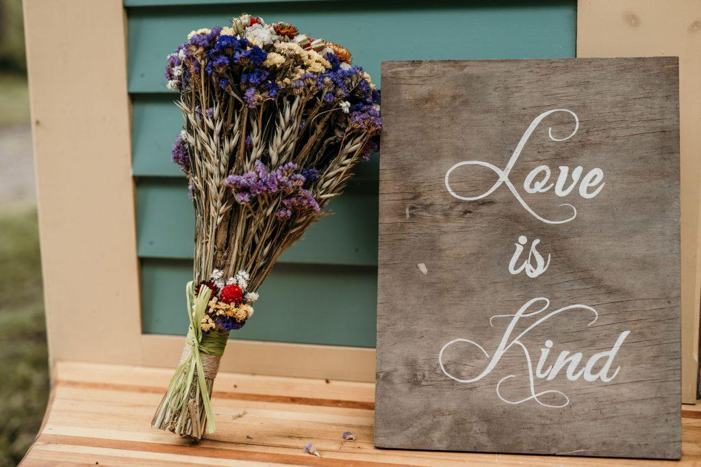 dried flower bouquet and love sign