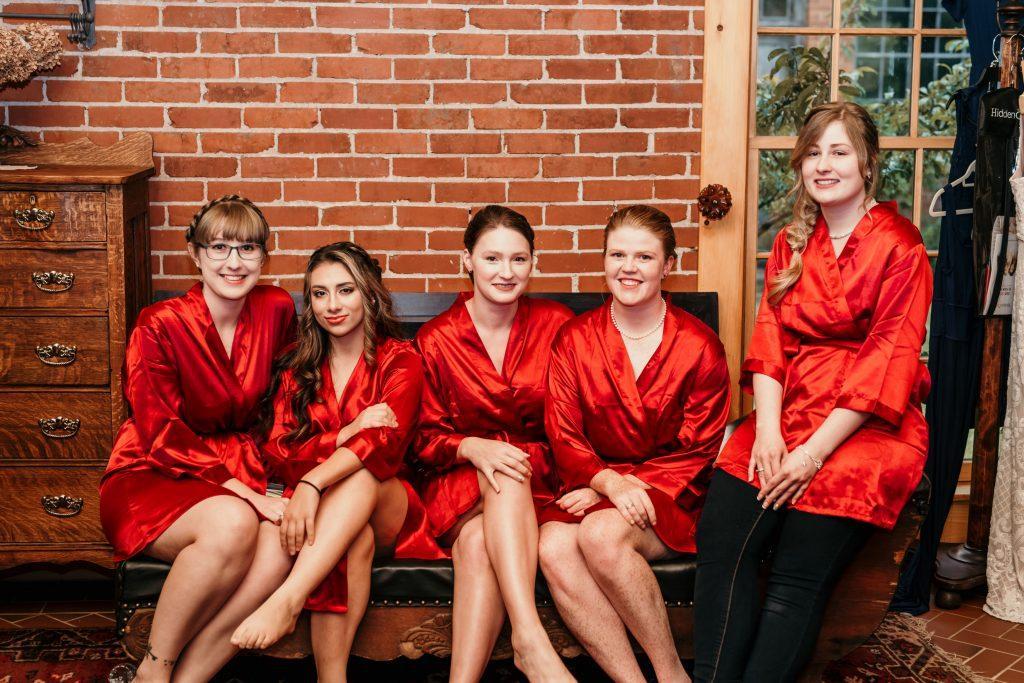 bridesmaids wearing red silk robes
