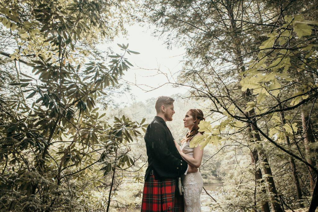 couple standing in the woods