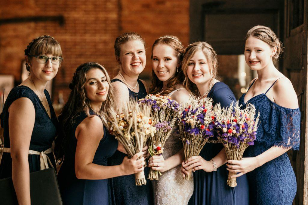 bride and bridesmaids holding dried flower bouquets
