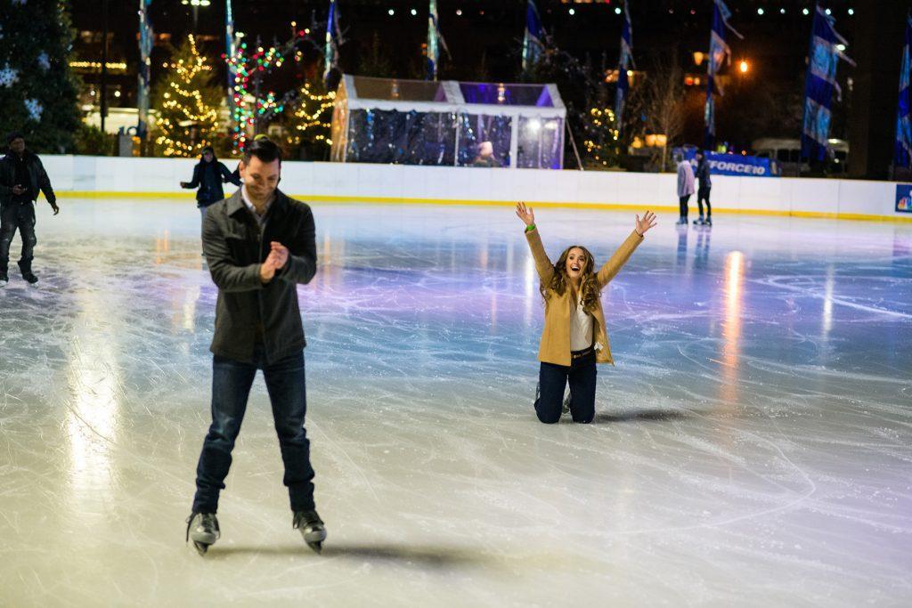 guy and girl having fun ice skating