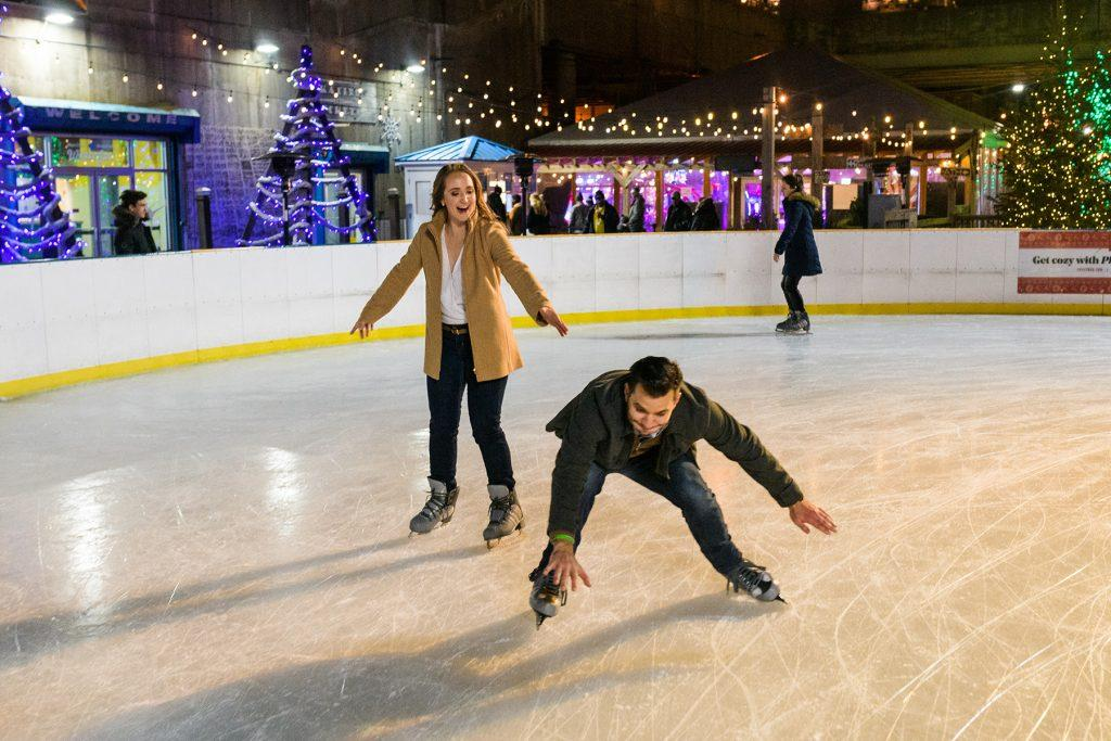 engaged couple ice skating fun