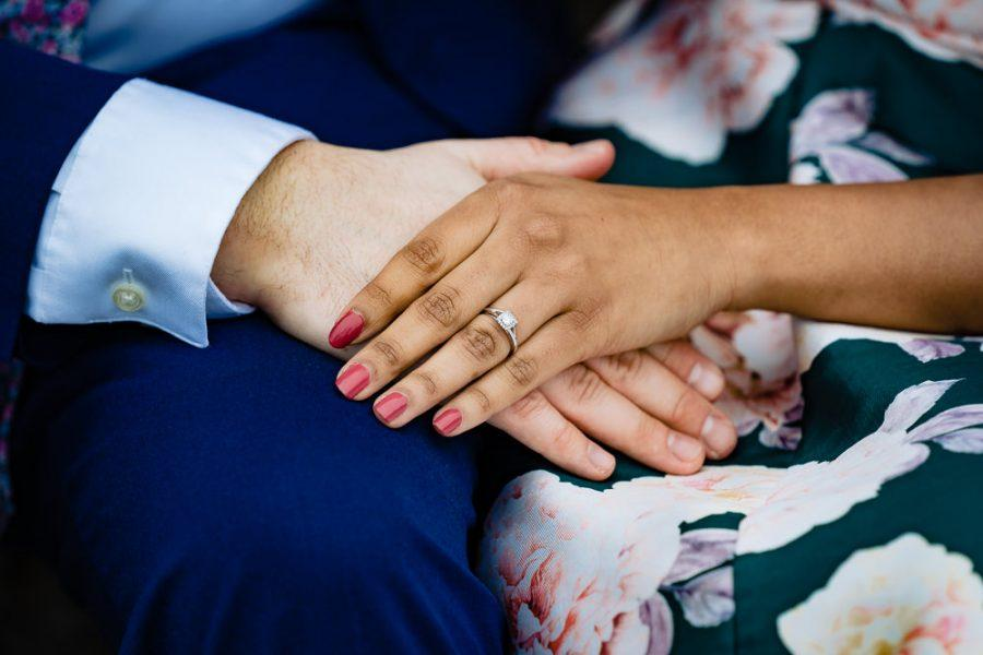 couple's hands with engagement ring