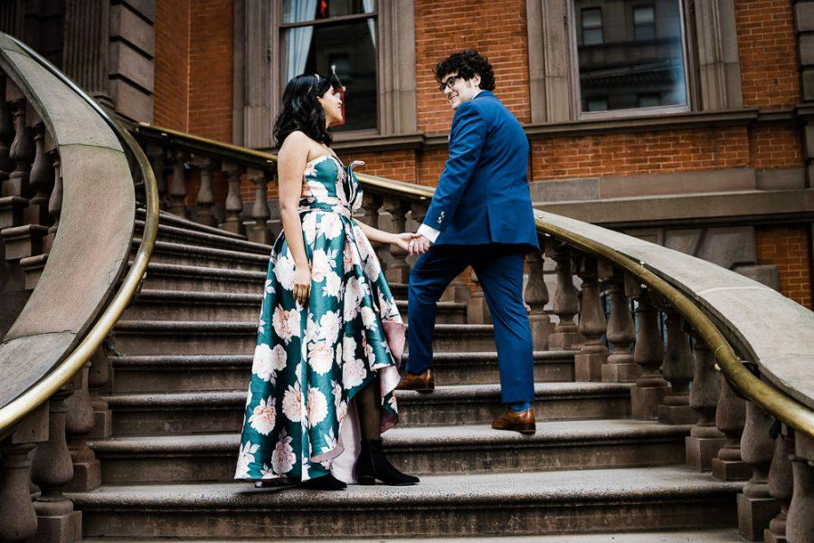 couple holding hands on stairs