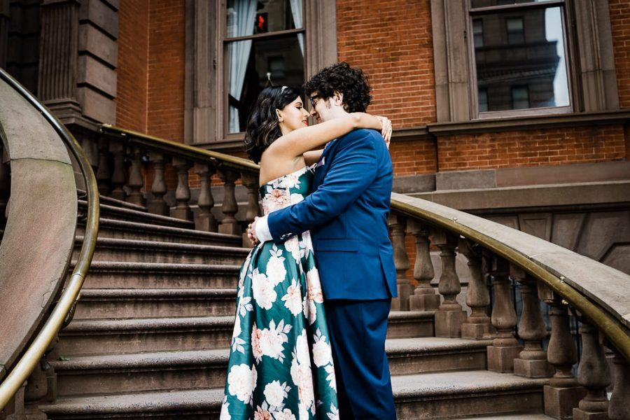 couple embrace on stairs