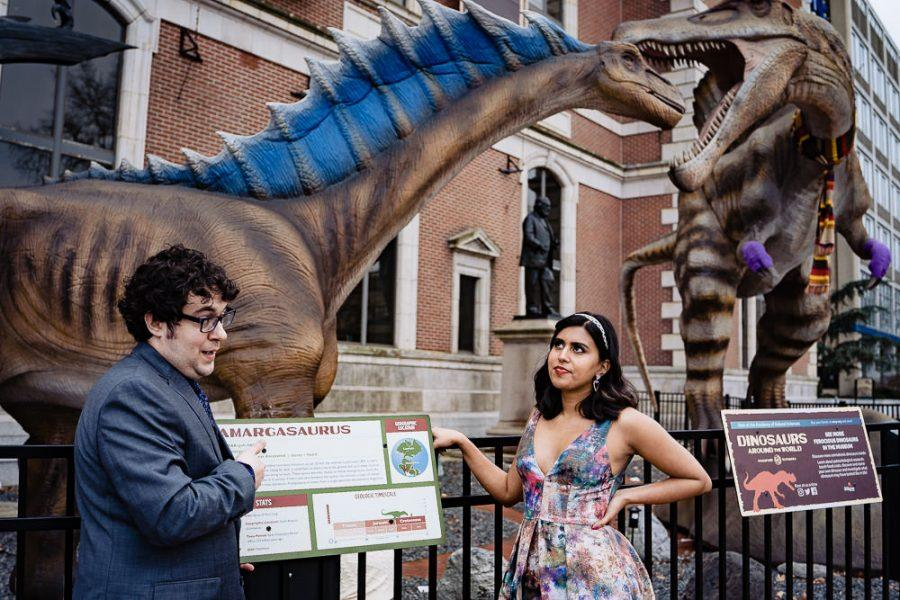 couple with dinosaurs