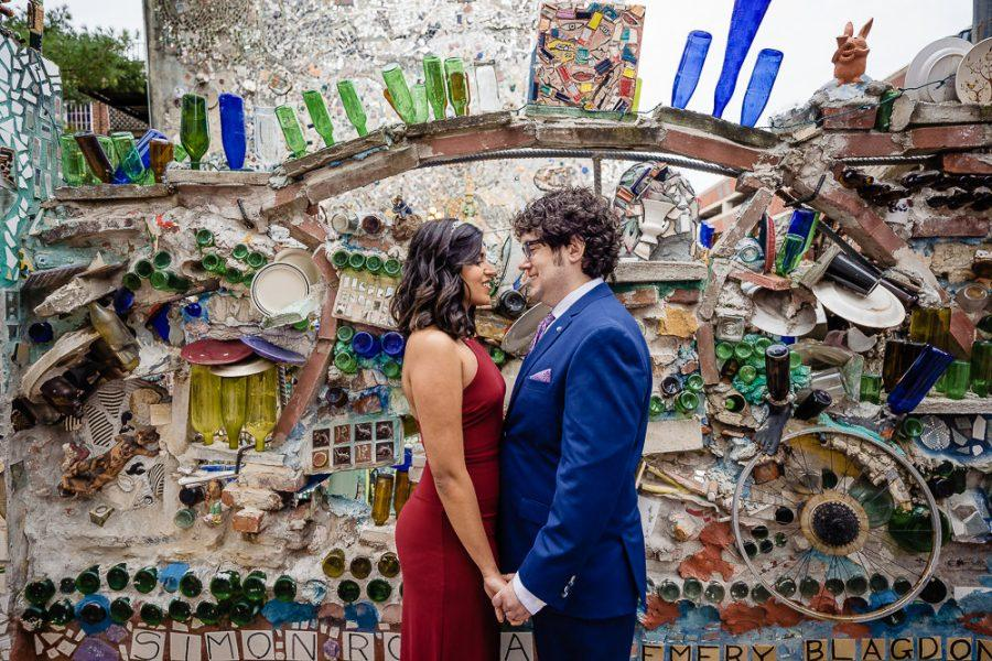 couple hold hands in magic gardens
