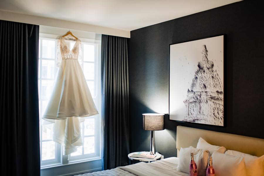 wedding dress hung in window