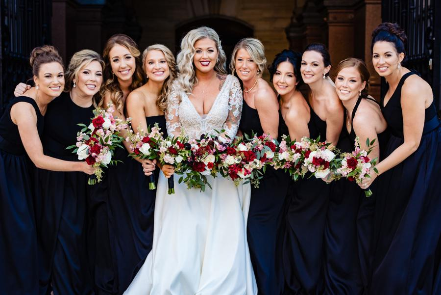 bride and bridesmaids holing bouquets