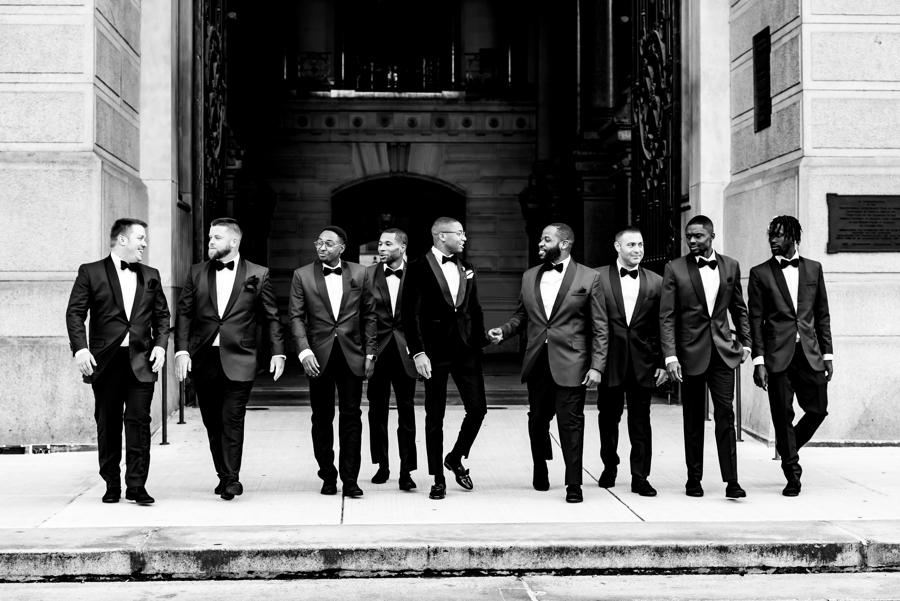 groom and groomsmen posed in front of philly city hall