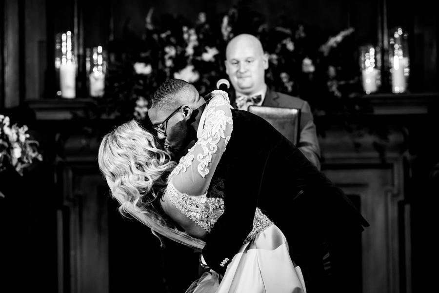groom kisses bride after being married