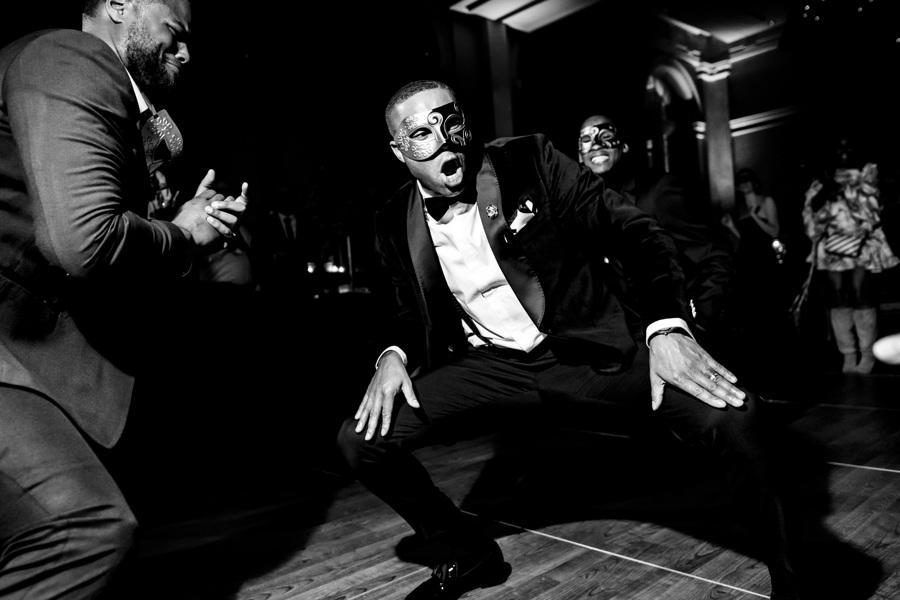 groom getting down on the dance floor