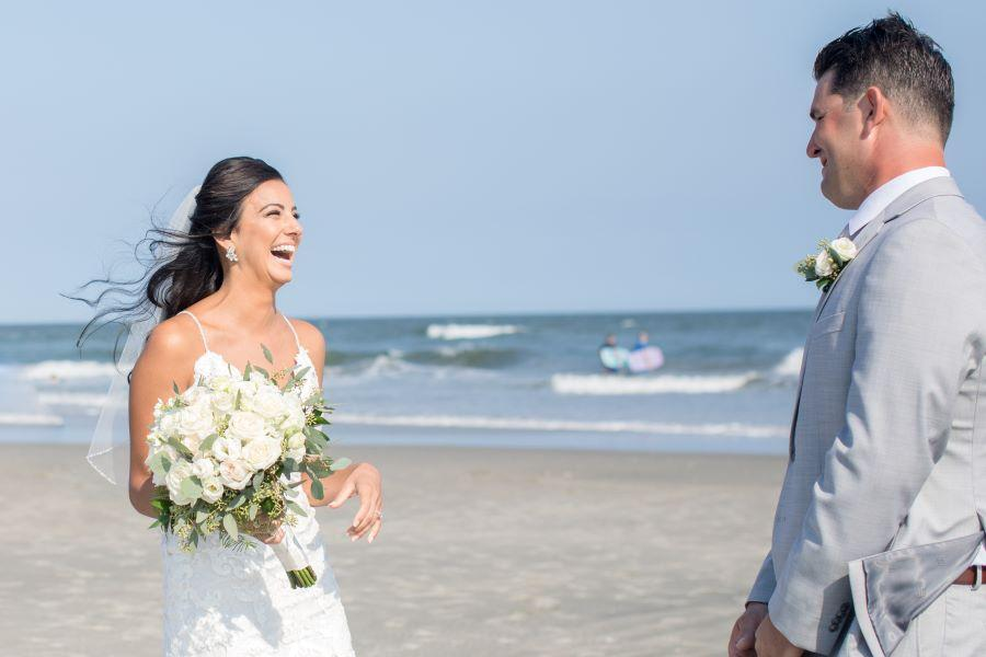 bride and groom first look on beach