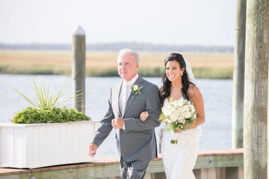 father walks bride daughter down the aisle