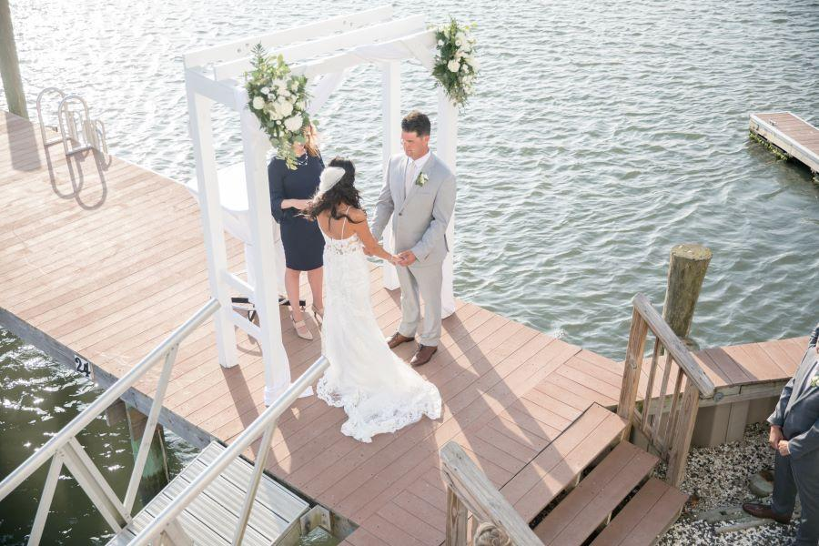 bride and groom on dock at wedding ceremony