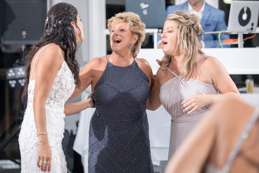 bride, mom and girlfriend sing