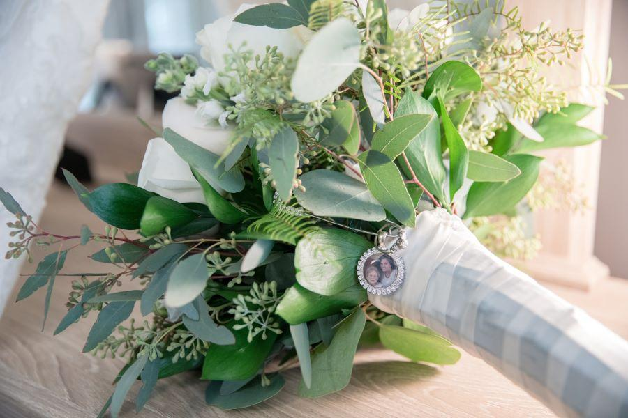 green bridal bouquet with locket