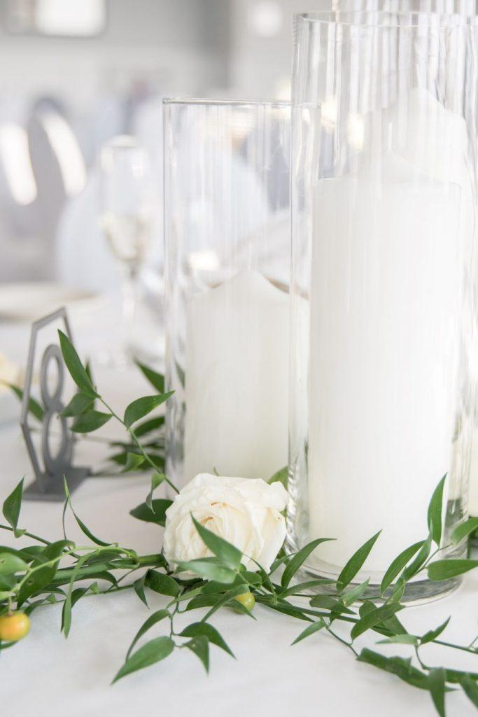 candles and glass hurricanes on wedding table