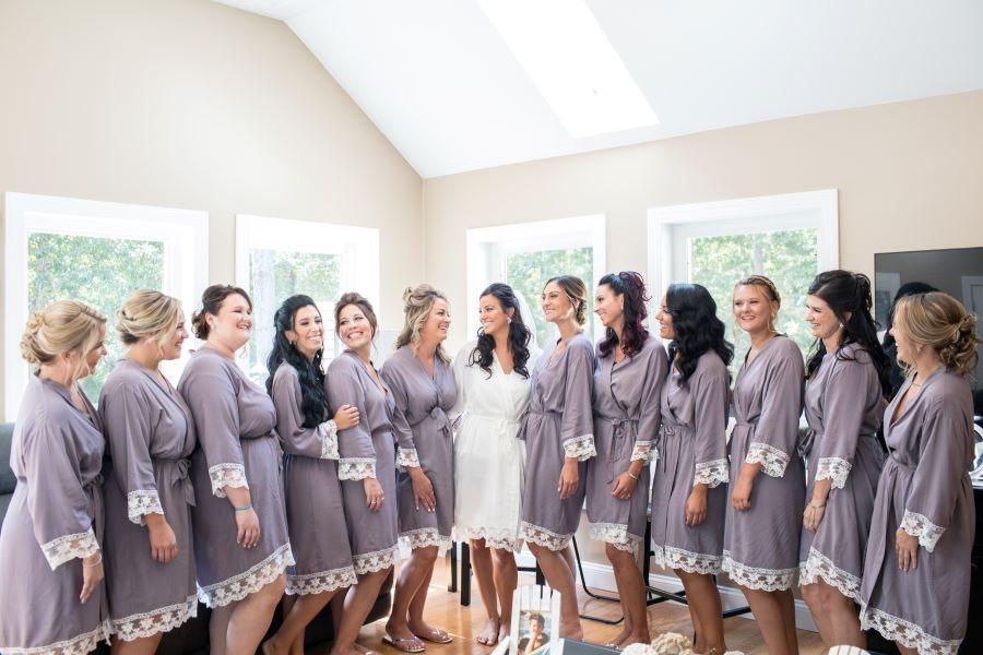 bride and bridesmaid getting eady in robes
