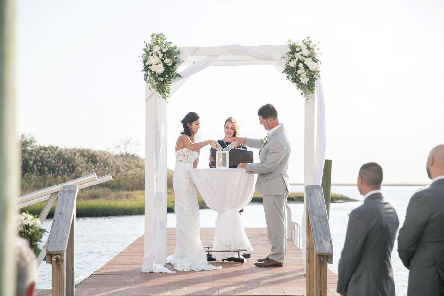 bride and groom pour sand in keepsake box
